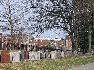 Brighton, Boston - Cemetery and apartment houses along Commonwealth Avenue, Brighton, near Chandler's Pond