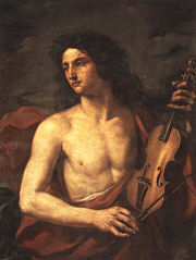 A young man with long flowing hair, bare chested, holds a stringed instrument in his left hand, while looking way to the left with a soulful expression