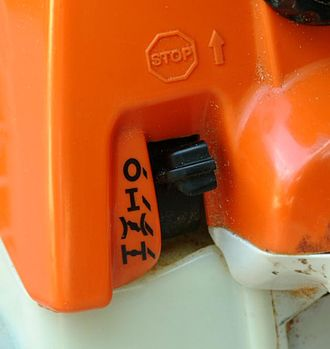 Chainsaw safety features - On/off switch