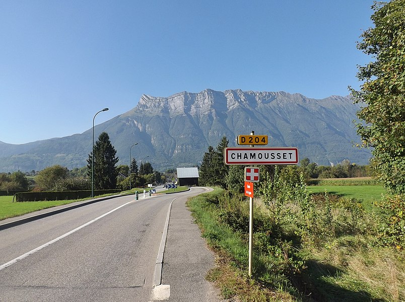 Welcoming sign into the French commune of Chamousset, with the Arclusaz mount at the background, in Savoie.