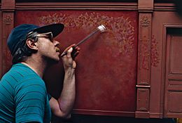 Charles Matton painting a red wall.jpg