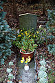 Church of St Mary Theydon Bois Essex England - churchyard gravestone and planter flowers.jpg