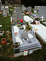 City of London Cemetery and Crematorium - Granite grave slab with plastic decorations.jpg