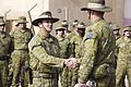 Col. Andrew Lowe Task Group Taji 3 commander, shakes hands with Col. Richard Vagg, , Task Group Taji 4 commander, during a transfer of authority (TOA) ceremony at Camp Taji, Iraq.jpg