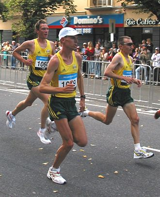 Gait (human) - Humans using a running gait. The runner in the back and on the far right are in the suspended phase, in which neither foot touches the ground.