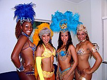 4 female samba dancers are shown posing for a picture during the 2008 Rio Carnival.