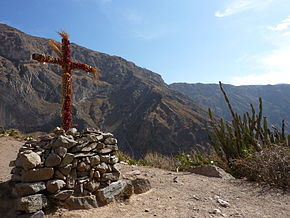 Cross with geraniums, Malata, Cabanaconde, Peru.jpg