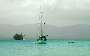 Cruising (maritime) - A cruising sailboat anchored in the San Blas Islands, in Panama.