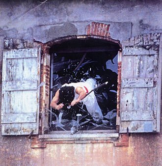 Defenestration - A stuntman diving out a window