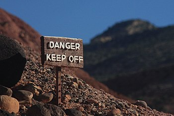 "English: A sign that reads ""danger, keep ..."