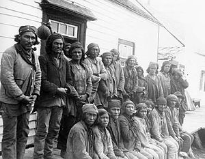 Davis Inlet - Innu traders gathered outside the Hudson's Bay Company post in Davis Inlet, August 1903