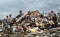 Defense.gov News Photo 110421-A-NR754-005 - Approximately 50 U.S. soldiers from the U.S. Army John F. Kennedy Special Warfare Center and School at Fort Bragg N.C. assist in the cleanup of a.jpg
