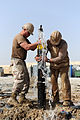 Defense.gov News Photo 120317-N-UH337-029 - Petty Officer Jon M. Wawrek and Petty Officer 2nd Class Michael A. Castaldi both assigned to Naval Mobile Construction Battalion 11 cap an.jpg