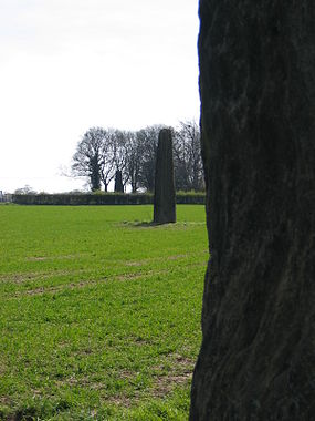 a line of three large standing stones