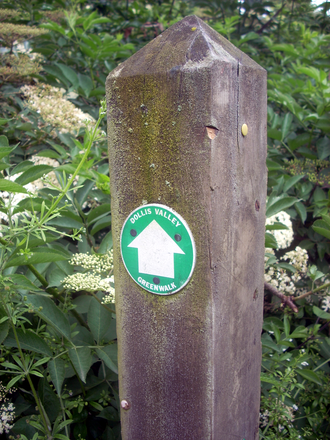 Dollis Valley Greenwalk - The Dollis Valley Greenwalk's logo, a white arrow on green, marks the route