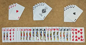 A 40-card Doppelkopf deck showing the three non-trump suits (four hearts, six spades, and six clubs), and the larger trump suit.