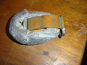 Diving weighting system - Lead clip-on diving weight by Draeger with bronze spring clip, c. 1980