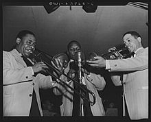 From left: Nanton, Harry Carney, and W. Jones at the Hurricane Ballroom, April 1943; Nanton and Jones using mutes
