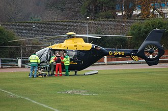 Emergency Medical Retrieval Service -  The EMRS team (red) with Paramedics (green) in 2009, loading a patient into a helicopter