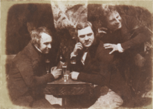 Sepia photograph showing James Ballantine, Dr George Bell and David Octavius Hill. Ballantine is on the left.