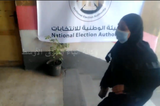 An Egyptian woman entering a polling station