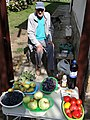 Elderly Man with Produce Stall - Berehove - Ukraine (36315799070) (2).jpg