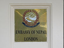 Plaque outside the embassy depicting the Emblem of Nepal