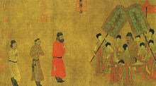 Painting of three men in respectful posture approaching a man seated on a palanquin and surrounded by attendants on the left