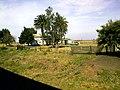 Estancia y campo al lado de la vía - panoramio.jpg