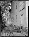 Exterior view along east elevation showing railroad. - Fisher-Fallgatter Mill, Waupaca, Waupaca County, WI HAER WIS,68-WAUP,1-4.tif