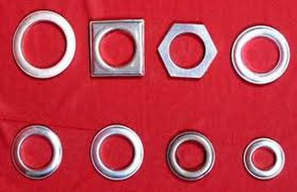 Grommet - Curtain grommets, used among others in shower curtains.