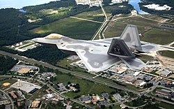 The first operational F-22A Raptor flies over Tyndall AFB on its delivery flight during 2003.