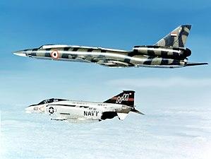"Libyan Air Force - A U.S. Navy McDonnell F-4N Phantom II intercepts a Soviet-built Tupolev Tu-22 ""Blinder"" bomber being delivered to the Libyan Arab Republic, circa April 1977."