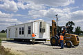FEMA - 36886 - FEMA mobile homes being placed in a staging area in Iowa.jpg