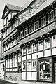 Fachwerkhaus - Augenoptik Kleinfeld, Neukirchenstrasse 34, Osterwieck, Harz, DDR. ORWO UP15 Schwarz-Weiss Diafilm, May 1 1990. (4413287302).jpg