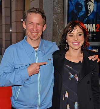 Figge Norling - Figge Norling and Lo Kauppi at the premiere of the film Jägarna 2 on 5 September 2011.