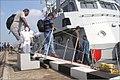 Fishermen embarking Ins Kalpeni.jpg
