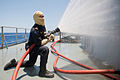 Flickr - Official U.S. Navy Imagery - A Sailor conduct a fire drill..jpg