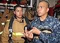 Flickr - Official U.S. Navy Imagery - Sailor instructs shipmates how to properly don a self-contained breathing apparatus..jpg