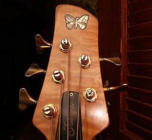 Fodera - Inlaid butterfly on Fodera headstock.