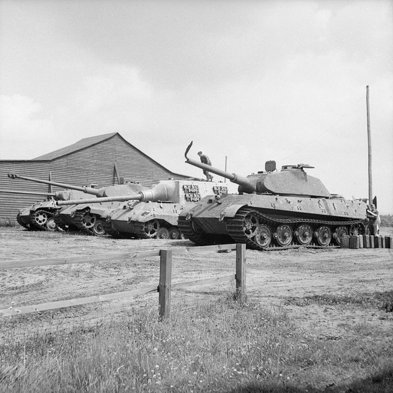 Four_German_heavy_tanks_at_the_Henschel_tank_testing_ground_at_Haustenbeck_near_Paderborn%2C_Germany in June_1945