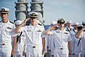 From left, U.S. Navy Lt. j.g. Robert Cary, Lt. j.g. Tradd Dobbins and Lt. j.g. Colleen Quinn salute during a burial at sea ceremony aboard the guided missile cruiser USS Hue City (CG 66) June 29, 2013, in 130629-N-ER662-330.jpg