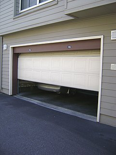 Garage door large door on a garage that accommodates vehicles entering and exiting