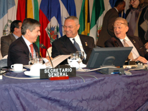 César Gaviria - César Gaviria heading the OAS session (left) and then US Secretary of State, Colin Powell.