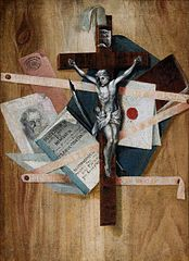 Crucifix against papers.