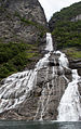 Geiranger, the Suitor waterfall, coming from a fissure in the rock wall.jpg