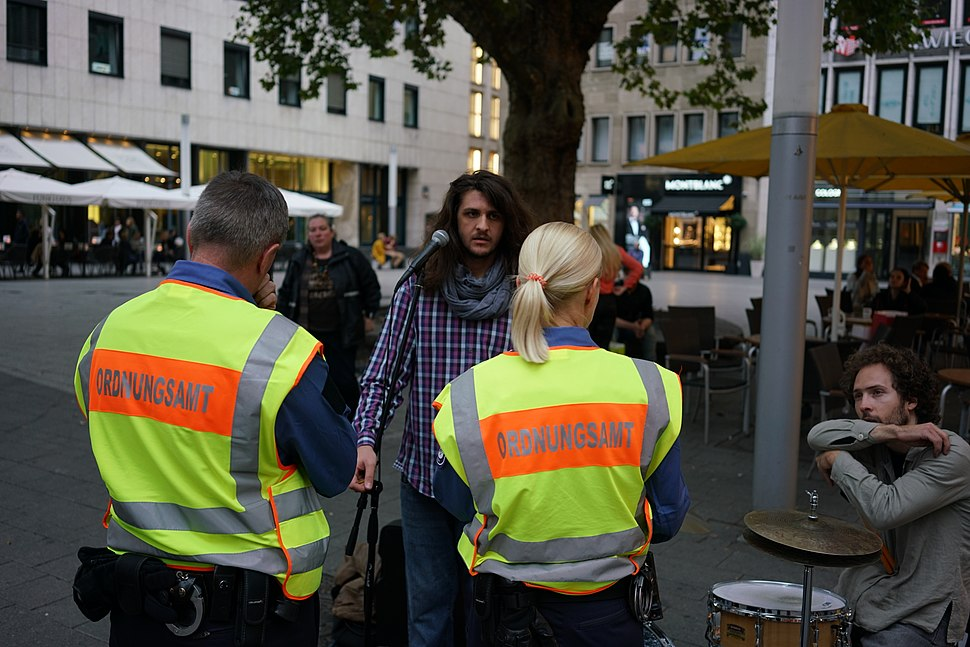 German Ordnungsamt and street musicians in Cologne, Germany