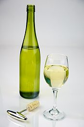 Glass of White Wine shot with a bottle of white wine - Evan Swigart.jpg