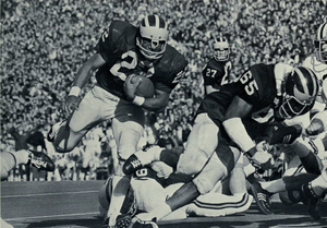 Reggie McKenzie (guard) - McKenzie (No. 65) playing for the Michigan Wolverines in 1971 with teammate Glenn Doughty (left)