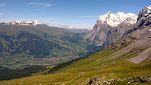Grindelwald - The Wetterhorn (3692 m a.s.l.) massif rises above the valley settlements of Grindelwald to the northeast